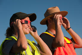 people using solar viewing glasses