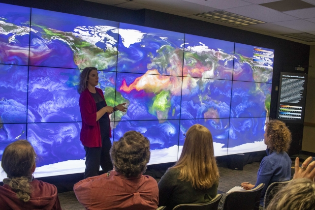 Lori Perkins describes colorful NASA visualizations at the Goddard Space Flight Center hyperwall